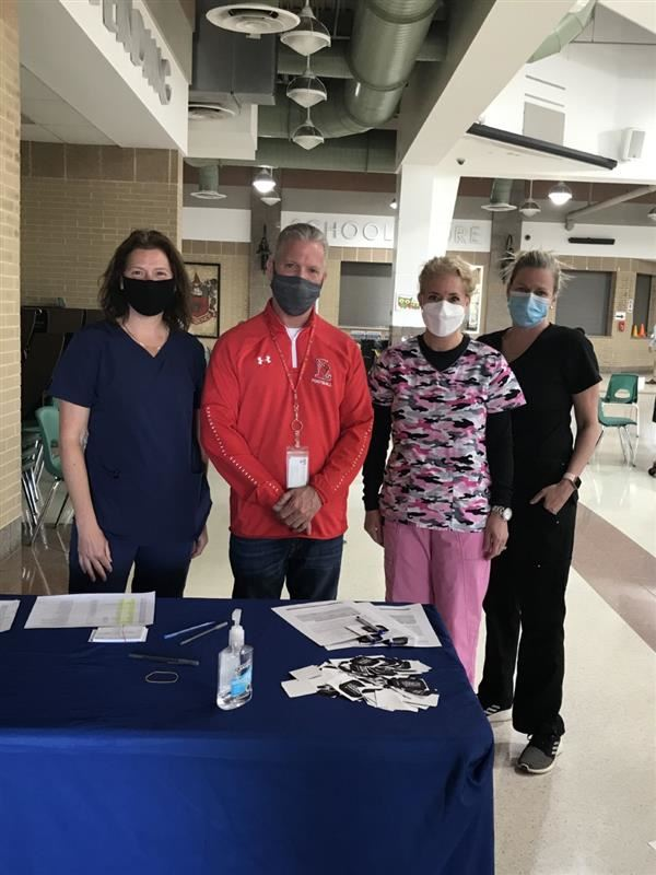Lawrence nurses with Superintendent Ross Kasun